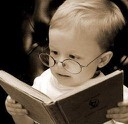 Picture of a baby with a book.